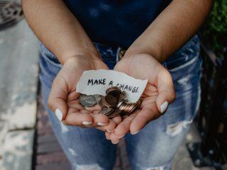 women holding change